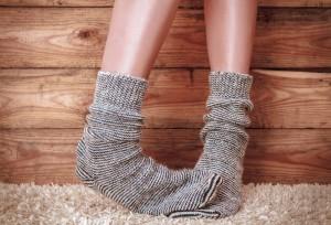 cold feet warm socks shutterstock_248949232