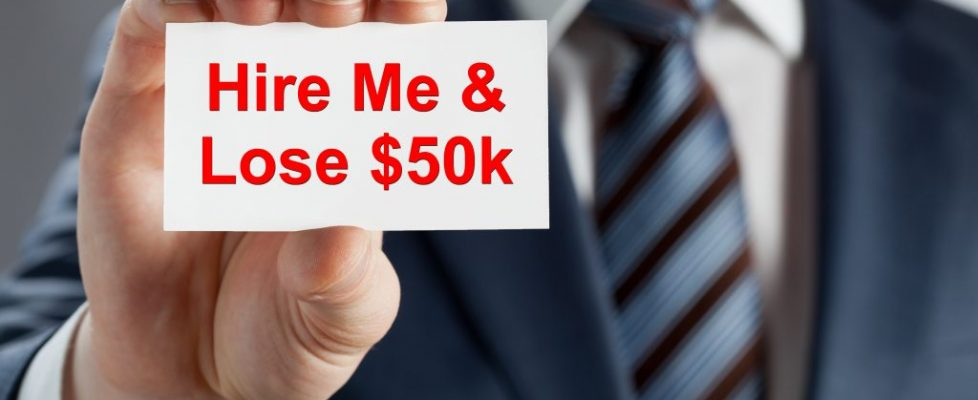 Text Added - Man holding Business card - poor performer - shutterstock_124567405
